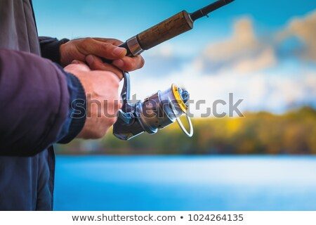 Fishing rod spinning blurred background Stock photo © cookelma