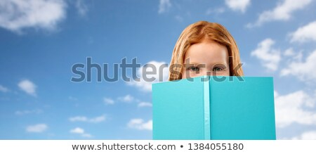 Rood meisje verbergen achter boek hemel Stockfoto © dolgachov