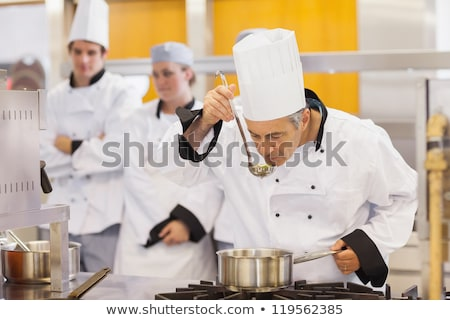 chef tasting food from ladle at cooking class Stock photo © dolgachov