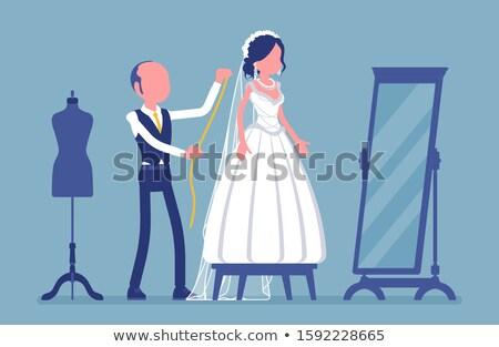 Stock photo: Choosing accessory for wedding dress