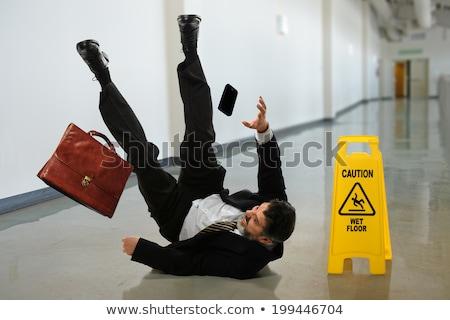 Empresário queda escorregadio piso local de trabalho homem Foto stock © AndreyPopov