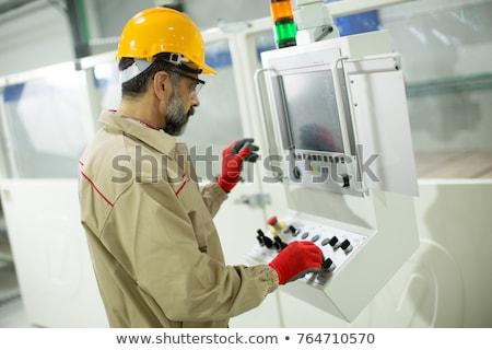 Bonito homem maduro trabalhando mobiliário fábrica homem Foto stock © boggy