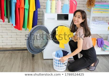 Asiático mulher sujo lavanderia casa Foto stock © dolgachov