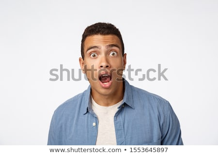 Omg no way. Impressed, shocked handsome questioned guy in blue shirt over t-shirt, drop jaw astonish Stock photo © benzoix