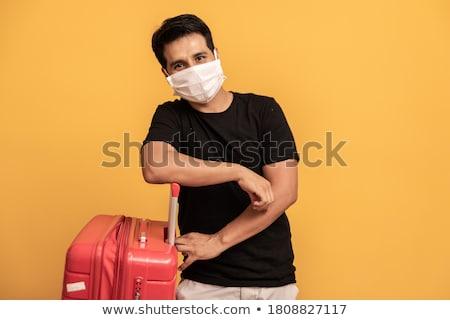 Man koffer chirurgisch masker jonge man Stockfoto © nito