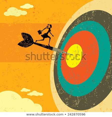 businesswoman with dart stock photo © dolgachov