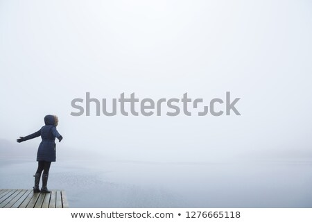young person with  open hands on footbridge Stock photo © Paha_L