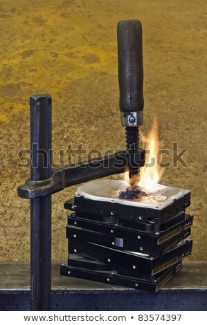 burning stack of hard drive pressed together with clamp Stock photo © gewoldi