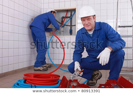 A team of plumbers at work Stock photo © photography33