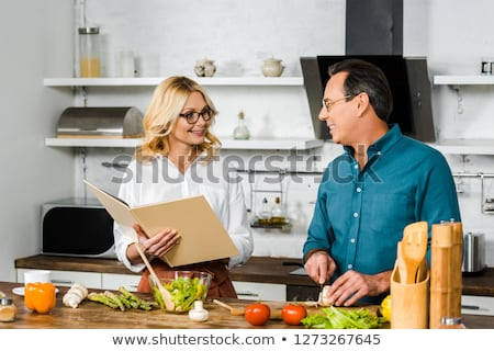 Mature couple looking at a recipe book Stock photo © photography33