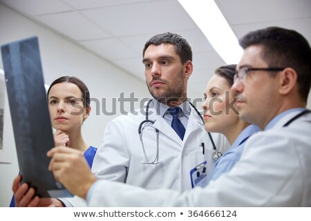 Medical team discussing an xray Stock photo © photography33