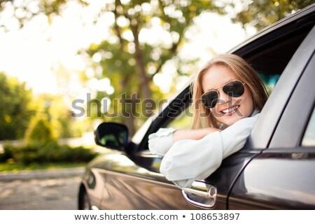 Blond meisje zonnebril rijden auto gelukkig Stockfoto © zurijeta