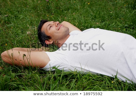 Man lying in the daisies Stock photo © photography33