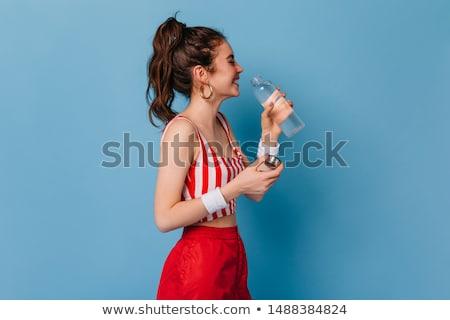 Hosszú lábak hölgy víz megnyugtató nő virágok Stock fotó © dolgachov