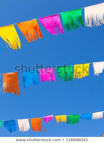 colorful tissue Paper fringe garland under blue sky Stock photo © lunamarina