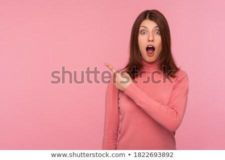 Shocked looking brunette. stock photo © lithian