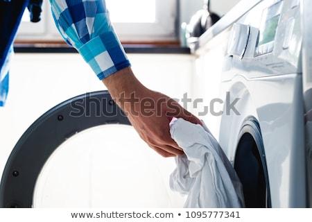 Chateado mulher lavanderia branco casa fundo Foto stock © wavebreak_media