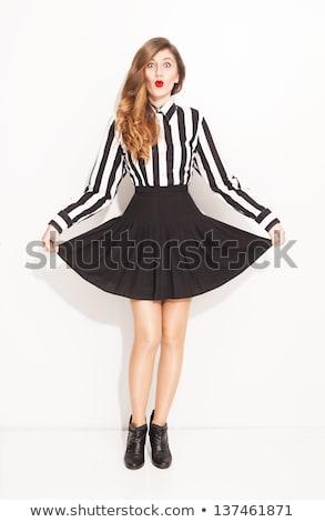 playful young woman in a black skirt stock photo © acidgrey