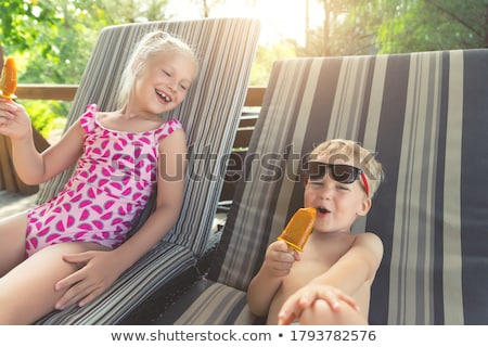 adorable little blonde girl having fun at the beach stock photo © feverpitch
