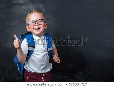 Fiatal iskolás fiú ujj felfelé izolált fehér Stock fotó © get4net