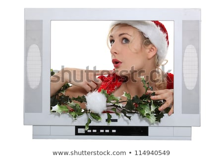 Woman with Christmas hat behind television frame Stock photo © photography33