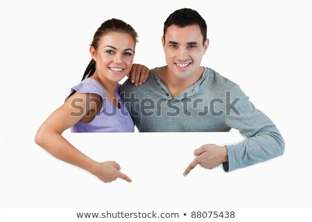 Couple pointing white panel Stock photo © photography33