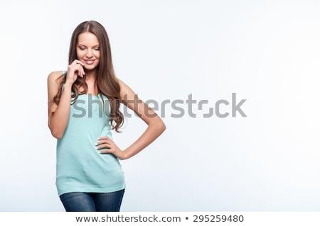 şaşırmış · genç · kadın · bakıyor · mavi · gömlek · yalıtılmış - stok fotoğraf © pablocalvog