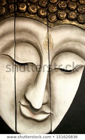 Wooden Buddha head carving Stock photo © Farina6000
