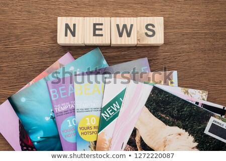 word top newswooden cubes on magazine stock photo © deyangeorgiev