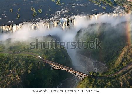 brug · rook · reizen · waterval · regenboog · afrika - stockfoto © TanArt