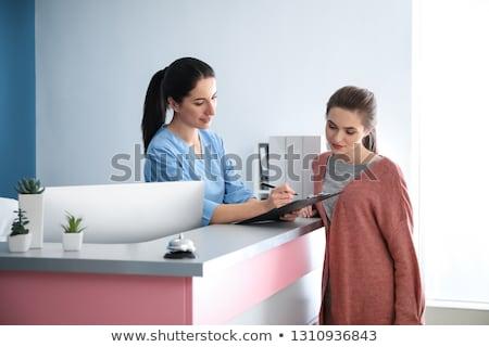 Stok fotoğraf: Kadın · resepsiyon · klinik · hasta · ofis · doktor