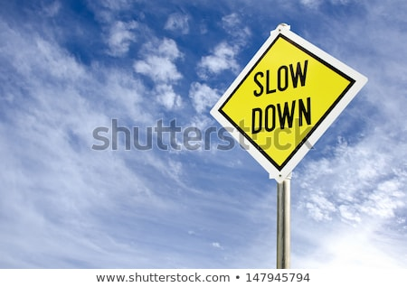 yellow warning sign   slow down   blue sky stock photo © iqoncept