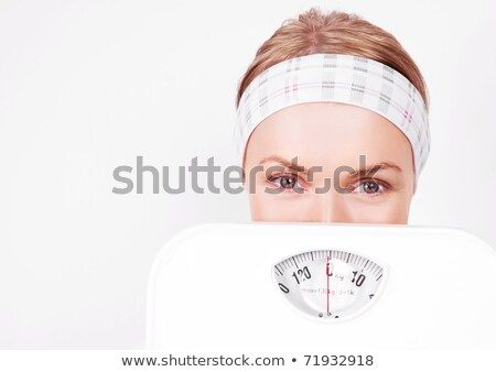 Excited woman loosing weight Stock photo © ichiosea