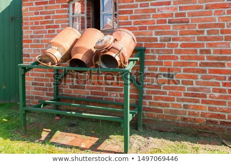 three churns on a farm Stock photo © compuinfoto