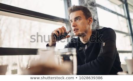 man using electronic cigarette to stop smoking stock photo © highwaystarz
