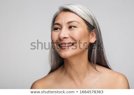 без верха женщина улыбается серый женщину позируют Сток-фото © stockyimages