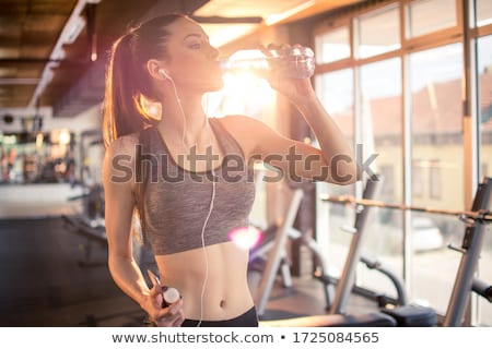 portrait of a tired fitness woman stock photo © deandrobot