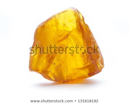 Pièce ambre isolé blanche lumière fond Photo stock © Taigi