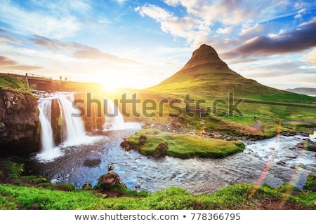 sunrise over the beautiful waterfall stock photo © tracer