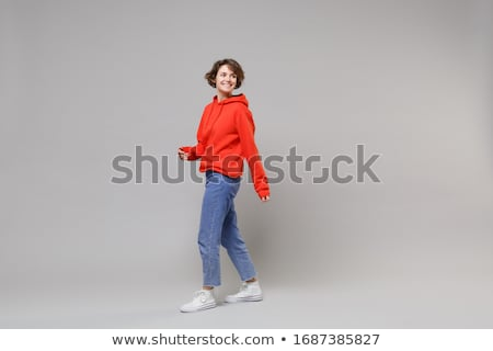 Full length portrait of a charming woman stock photo © deandrobot