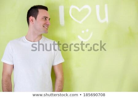 Man schilderij liefde woord muur jonge man Stockfoto © fuzzbones0