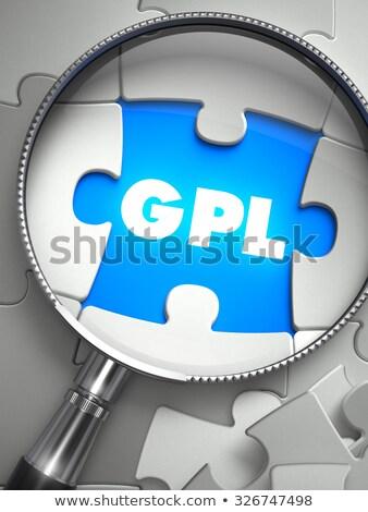 gpl   missing puzzle piece through magnifier stock photo © tashatuvango