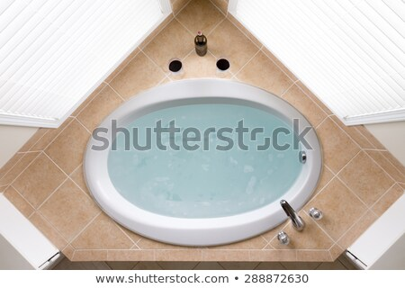 Stock photo: Corner oval bathtub full of clean water