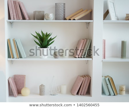 books on white shelves stock photo © tetkoren