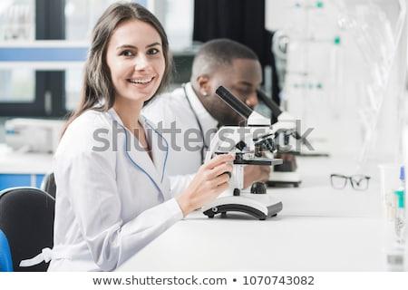 Heureux microscope laboratoire femme technologie Photo stock © wavebreak_media