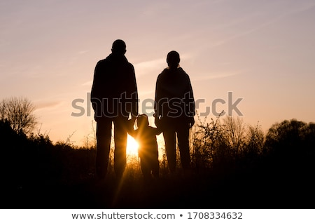 Stock photo: father and children on sunset