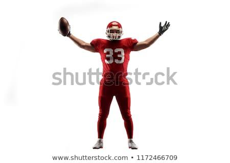 American football player. Studio shot over black. stock photo © nickp37
