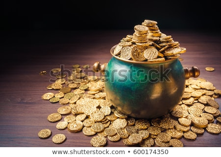 Pot of gold coins. Full cauldron of gold Stock photo © orensila