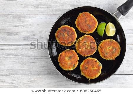 pan fried fish patty stock photo © digifoodstock