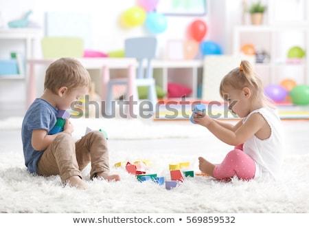 Child playing with construction blocks Stock photo © zurijeta